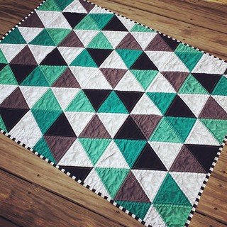 Since this gift is now received by my adorable new nephew, I can finally share this pic! #modernquilt #babyquilt #modern #triangles #konacotton @robertkaufman