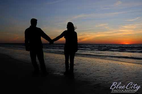 pictures ocean sky orange beach gulfofmexico water silhouette clouds portraits sunrise coast engagement sand couple texas photos shots tx young holdinghands freeport engaged lakejackson quintana brazoriacounty bluecityphotography bluecityphotographycom
