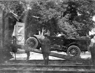 Car being loaded onto a train at De Leon Springs for a trip to Buffalo, New York