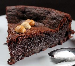 Flourless Nutella Chocolate Cake with Hazelnut halves for World Nutella Day 2011   by MsAdventuresinItaly