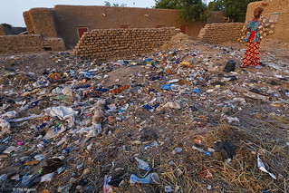 young girl dumps garbage early one morning - Djenne, Mali | by Phil Marion