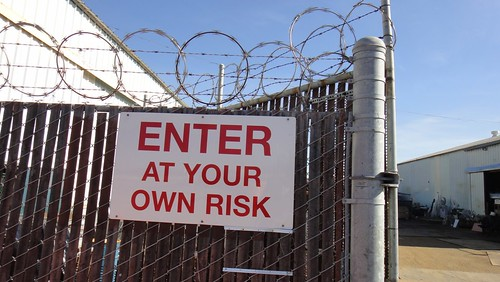 Barbed Wire Cyclone Fence Sign, Enter At Your Own Risk | by Lynn Friedman