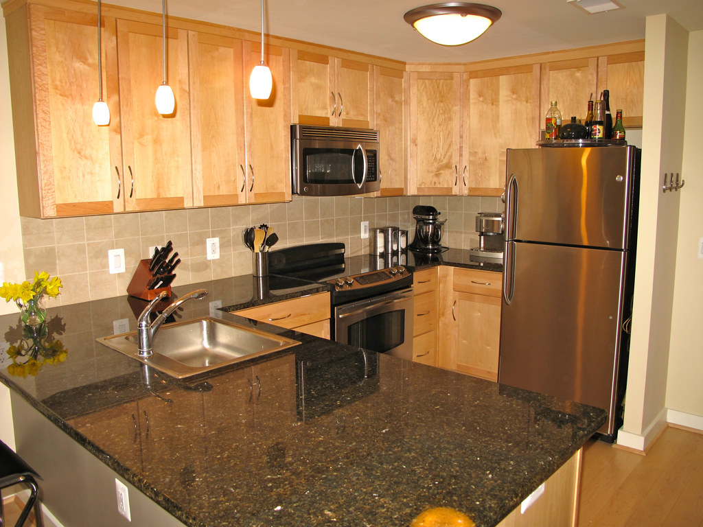 Granite Counter Tops Maple Cabinets And Stainless Steel Ap Flickr