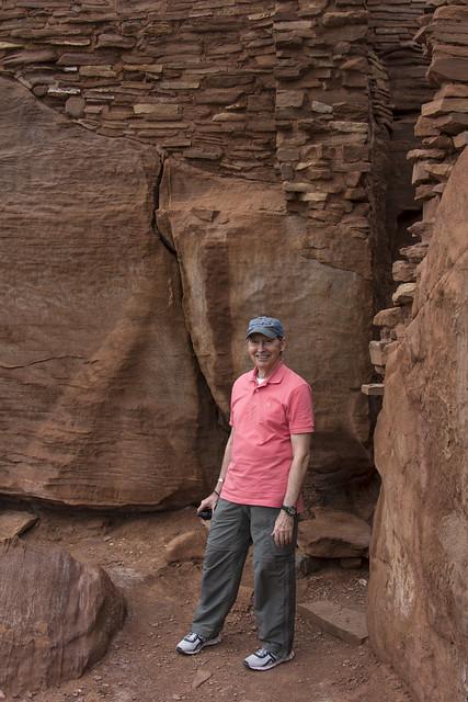 Standing beside an ancient Sinagua pueblo dwelling in Arizona's Wupatki National Monument