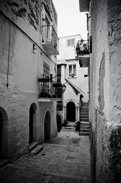 light in the narrow streets of an old city in italy I