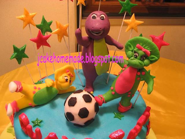 Barney playing foot ball