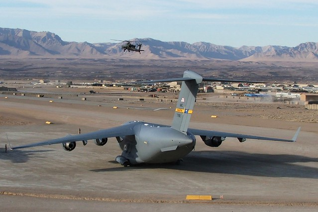 Overview of the unpaved runway near Camp Holland. In the foreground is C-17A Globemaster-III 07-7182 437AW