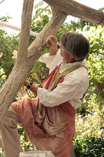 Terry Eagan restores a portion of the rose garden's faux bois arbor. | by More Cow Bell