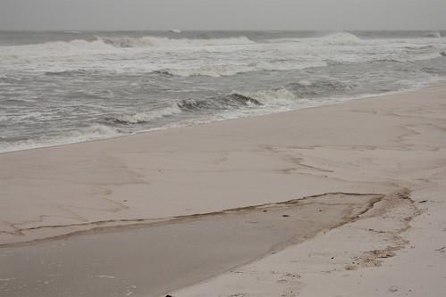 storm beach water dark sand waves florida pensacola