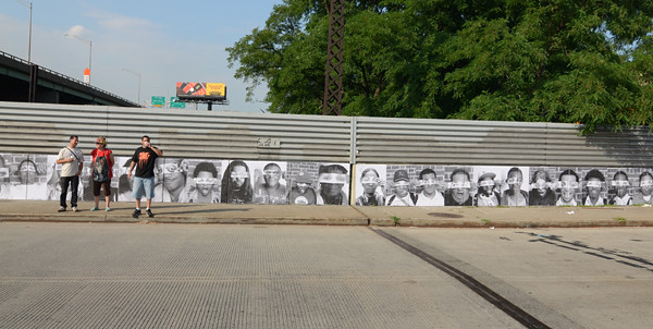 JR Photo Mural In South Bronx With Crew and Art Worker From The Point.
