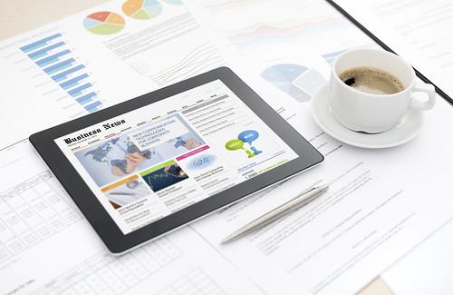 Business news website on digital tablet   by bill.sarris