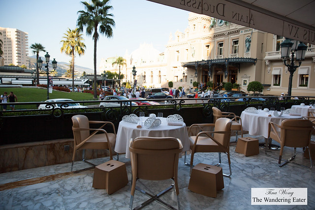 Outdoor seating area with a view of the very expensive and rare cars