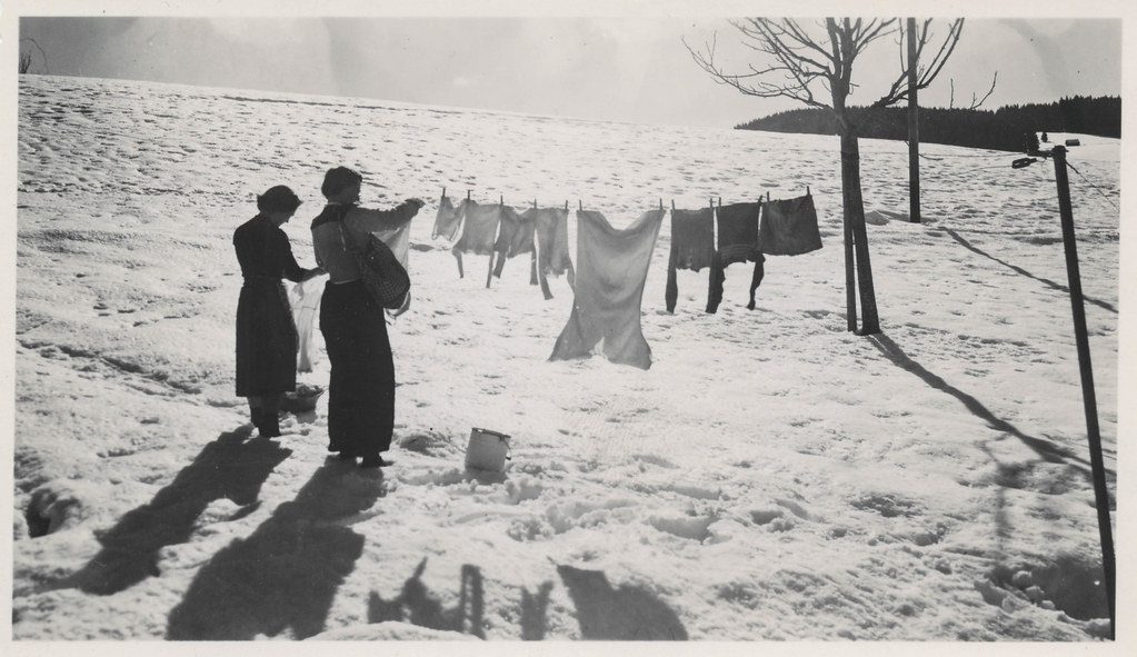 Women hanging laundry in the snow