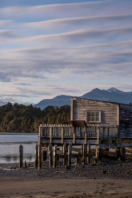morning light on okarito boatshed ii