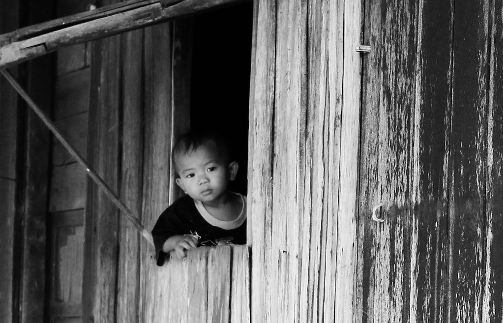 Looking Out My Window A Filipino Child Looks Out The Windo Flickr