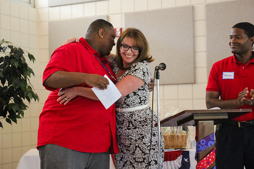 After receiving the GAL Youth Supporter Award, Brian Williams hugs Deborah Moore as Brian Sealey claps at Guardian ad Litem Appreciation Day on May 12, 2012 in Tallahassee, Florida. | by flguardian2