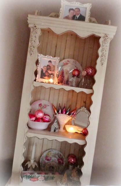 Shelf in living room w/ Christmas decor