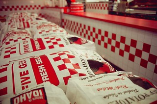 visit to five guys: bags of potatoes as dividers | by cafemama