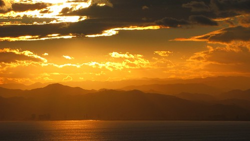 poverty travel sunset sea newzealand summer landscape bay scenery nz northisland gisborne sunray eastland
