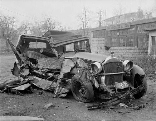 Wrecked car hauled to auto yard