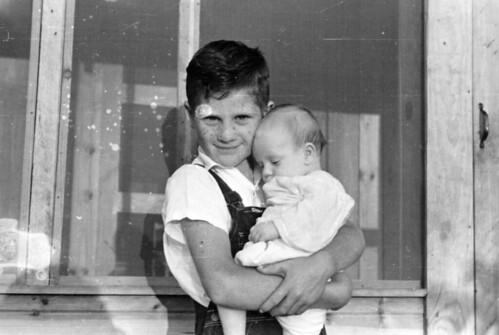 Young boy holding a baby at Delta Cooperative | by Kheel Center, Cornell University Library