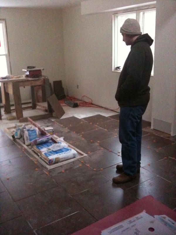 Jay admiring the kitchen floor.