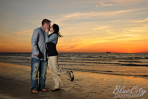 pictures ocean sky orange beach gulfofmexico water clouds portraits sunrise coast engagement sand kiss kissing couple texas photos shots tx young freeport engaged lakejackson quintana brazoriacounty bluecityphotography bluecityphotographycom