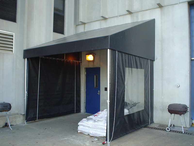 Awning with wind barrier