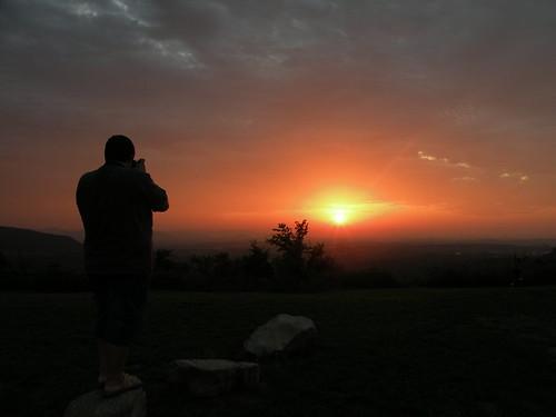 light sunset shadow orange sun mountains color colors person evening hills arkansas ozarks