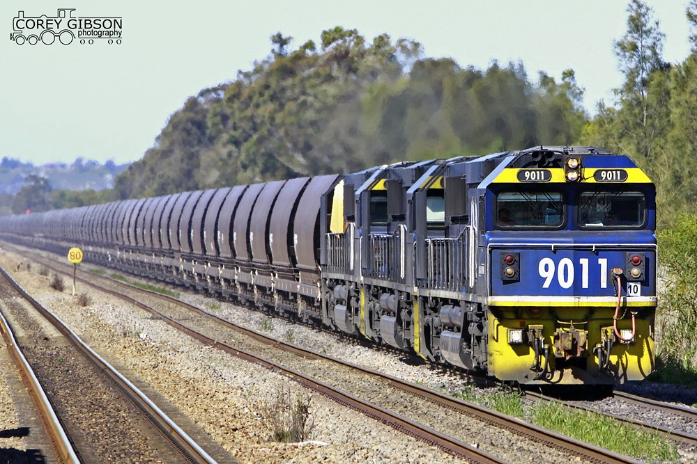 9011 with an empty rake of coal wagons by Corey Gibson