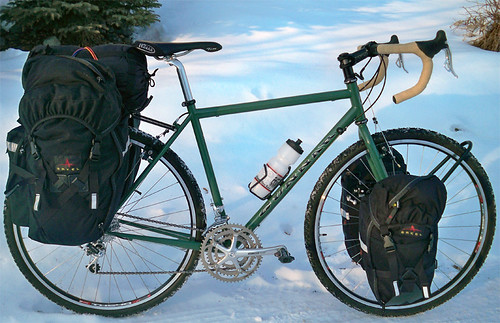 <p>This Gunnar Grand Tour 54cm in Monetary Green w/Black decals is ready to rock with front and rear panniers from Arkel - as well as Tubus racks.  Photo by Leonard Fancher by Anchorage, AK Feb 2011.  He reports: &quot;Cool.  Rides very straight.&quot;  60411</p>