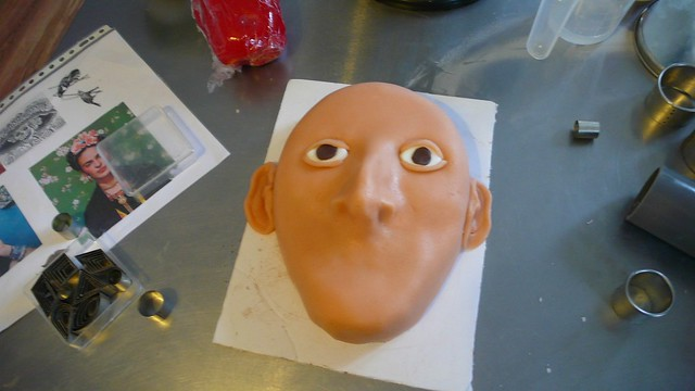 Frida Kahlo Cake after covering, ears and eyes