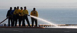 Sailors aboard USS Makin Island conduct fire hose training. | by Official U.S. Navy Imagery