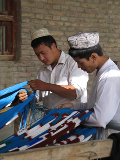Uyghur men sorting strands of dyed silk - Hotan, Xinjiang | by retrotraveller