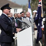 110419 The Commanding Officer of No. 453 Squadron, Wing Commander Karl Holzmann delivered the bible reading during Flight Lieutenant Henry %u2018Lacy%u2019 Smith%u2019s funeral service at the Ranville War Cemetery