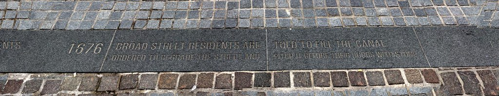 """Inscription on road reads : """"1676 broad street residents are told to fill the canal  ordered to regrade the street and pitch it before their doors with stone""""  6 handheld shots photomerged in Elements 9........"""