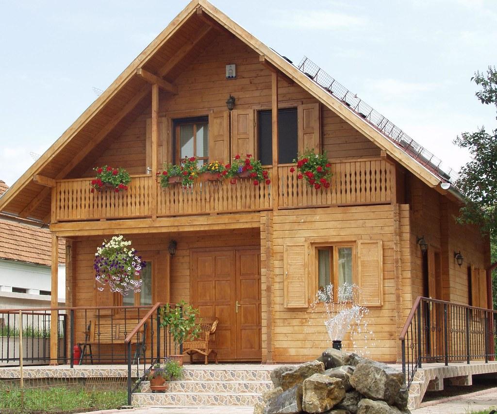 04 casa con struttura in legno romania resinosi iam79 for Casa in legno romania