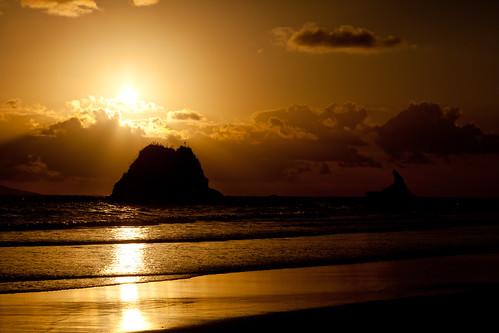 newzealand cloud sun beach water sunrise sand northland nzl mangawhai sentinelrock mangawhaiheads mangawhaibeach suninframe