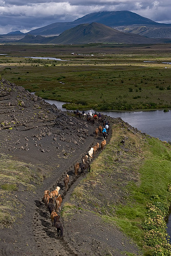Riding along the river Rangá going to the direction of the volcano Hekla | by Hekluhestar