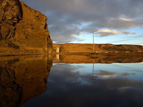 cliff reflection landscape golden still pond dusk farm telephone pole skógafoss skógar