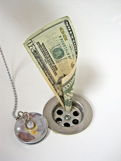 Dollars down the Drain | by Images_of_Money