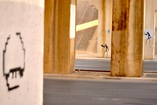 Two Stormtroopers, a grenade and a 1-UP walk under a bridge...