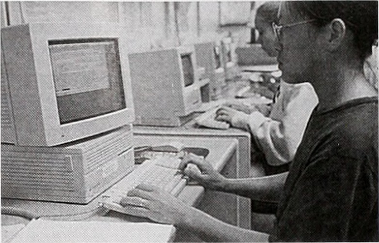 Students using computers, public domain