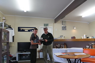 Jye Irving being presented the capsize trophy by Will Perry | by PLSC (Panmure Lagoon Sailing Club)