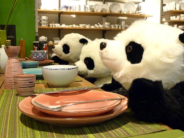 Pandas at the dinner table.  Store display in Kensington High Street, London