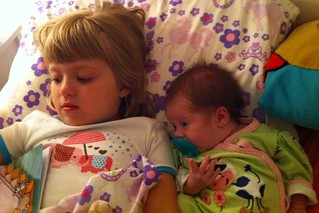 Sisters cozied up at bedtime | by poobou