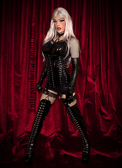 Latex corset, boots, gloves and fishnet