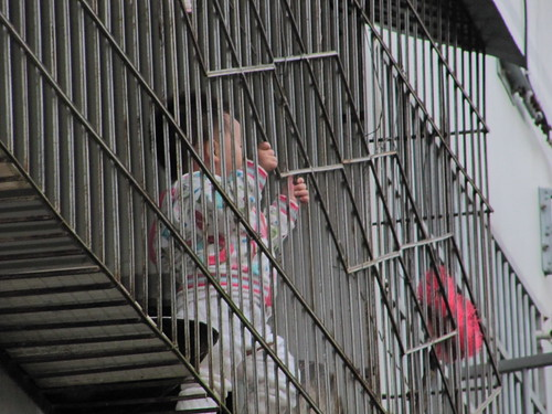 Child playing on the caged balcony | by everlutionary