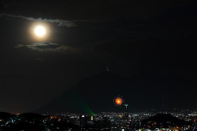 Blue moon (burned, I know) + laser beam (an inland lighthouse) + fireworks = MONTERREY, Mx =D
