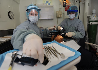 Dental procedure aboard USS Abraham Lincoln.   by Official U.S. Navy Imagery